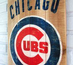 This sign features the Chicago Cubs logo hand-painted on reclaimed pallet wood by VintageSignDesigns.