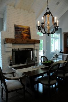 Painted Brick Fireplace + reclaimed wood + art