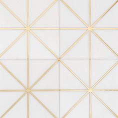 'Carlyle' - The Ellington Collection - White stone tile with a gold metallic design inspired by the Jazz Age and Art Deco - Available at World Mosaic Tile in Vancouver
