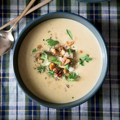 Creamy Parsnip Soup with Pear and Walnuts | Chef Marcus Samuelsson's soup is earthy and rustic with delicious Indian spices.