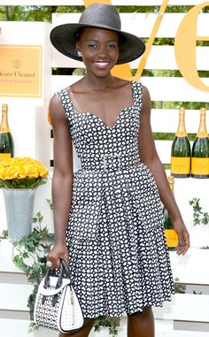 Lupita Nyong'o looks stunning in a black sunhat and Alexander McQueen black-and-white dress!