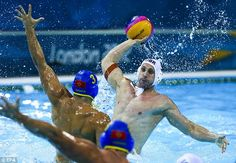 Making a splash: Great Britain's Craig Figes fires off a shot at goal