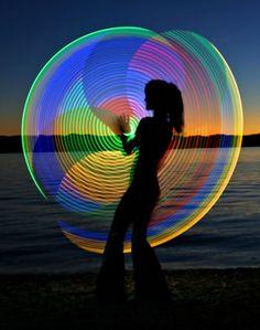 Peri Pierson of HavaHoop spins an LED hoop. Photo by Jillian Danielson