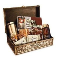 """Holiday Chocolate Gift Box - Box includes: 1 lb snowflake Belgian chocolate bar with full-color, holiday lid; 16 oz stainless steel travel mug; 6.25 oz European cocoa; 2-3.2"""" sugar cookies topped with chocolate; 5 oz mixed chocolate covered nuts; 5 oz milk chocolate peanut butter pretzels; 3.5 oz cabernet wine gels; 2-3"""" round white chocolate/candy cane in gift box.  Price $79.95 Each"""