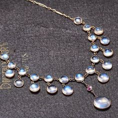 Art Nouveau Moonstone and Ruby Necklace, c. 1900, 9k yellow gold, rainbow moonstones, .20ct ruby.