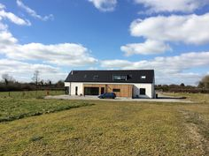 Our simple modern home in rural Ireland. Finished in cedar and monocouche render. View from back garden