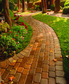 Curving path and bricks laid lengthwise create a sense of movement and a desire to explore what's around the bend.