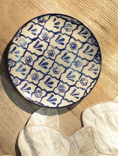 This delicately hand painted ceramic plate is sure to add rustic colour to your dining table