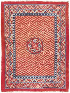 This antique Tibetan rug makes a grand impression with an endless pattern of Tibet, Early 20th Century - Rendered in a whimsical combination of ivory, vermillion and ultramarine blue, this charming antique rug from Tibet features elegant floral borders, a grand ogival medallion and an endless background of interlocking Pinyin-Wan fretwork motifs rendered in a striking combination of ivory and vermillion red. Set among an entangled sea of articulate fretwork motifs..
