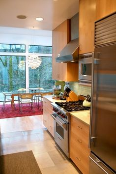 love the kitchen and the light fixture