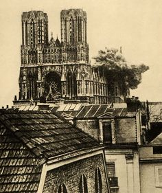 Rheims Cathedral, France, being bombed by the Germans during World War I (1917).. Never sure if it's Reims or Rheims....