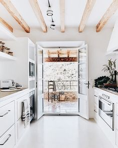 white and natural wood kitchen //