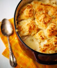 Piping hot creamy chicken stew topped with golden, buttery biscuits.