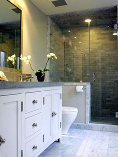 Love this half wall and seamless shower.