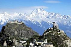 The castles of Tourbillon, left, and Valère, right, are dwarfed by the Bietschhorn mountain
