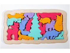 Puzzle and balancing game Forest Animals by thewoodenhorse on Etsy, $29.00 This shop has so many neat toys!