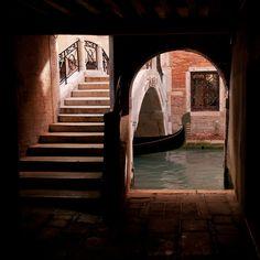 Gondola passing under Bridge, Venice, Italy