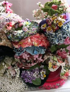 Vintage hats via Nostalgia at the Stone House. Look at all these pretties. A floral garden on your head.