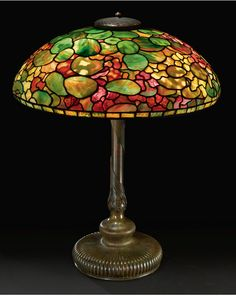"A FINE ""NASTURTIUM"" TABLE LAMP  Estimate: 125,000 - 175,000 USD     with an exceptional elaborately decorated applied coil base  shade with small early tag impressed   circa 1905"