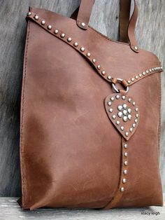 The product Equestrian Large Leather Vintage Harness Tote Bag with Silver Studs is sold by stacyleigh in our Tictail store.  Tictail lets you create a beautiful online store for free - tictail.com