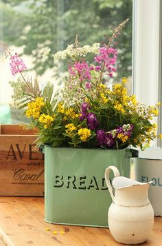I love my green enamel ware bread bin which I bought in Wales.  The arrangement is pretty but I would never do that to my lovely bin!   chw