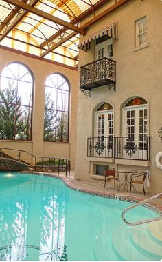 Wrought iron balconies open to the indoor swimming pool at El Paisano Hotel in Marfa, Texas. Outdoor Pool, Indoor Outdoor, Outdoor Living, Piscina Interior, Indoor Swimming Pools, Lap Pools, Backyard Pools, Pool Decks, Dream Pools