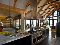 This contemporary kitchen anchors the home's open floor plan. Warm browns, cool tans and brilliant yellows inspired by fall foliage balance the industrial feel of restaurant-style appliances.