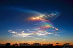 Extremely rare atmospheric phenomenon called rainbow bridge or circumhorizontal arc: when the sun is at least above horizon and ice crystals in clouds form rainbows. All Nature, Science And Nature, Amazing Nature, Beautiful Sky, Beautiful Landscapes, Fire Rainbow, Rainbow Bridge, Rainbow Light, Wild Weather