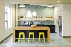 Yellow tolix stools at wood counter. New art nook off kitchen