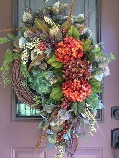 Autumn Wreath, Fall Wreath, Hydrangea Wreath, Front Door Wreath, Elegant Wreath, Grapevine Wreath This wreath features gorgeous hydrangeas in sunset orange and chocolate brown nestled among a beautiful autumn mix of various berry clusters and realistic natural spiraling greenery. Perfect colors for the autumn season! Measurements are approx. 24 wide 36 long & 6-7 deep. All measurements are tip to tip including cascading greenery. This wreath will be created on a grapevine wreath base ran...