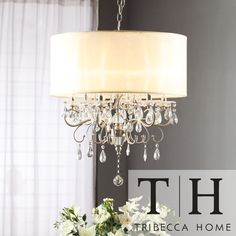 Update any dining room with this elegant Drum Shade Chandelier. Intricate glass crystal design that shimmers in the light will breathe a sense of beauty into a room. The ivory banded light shade will keep the lights low to set the right mood.