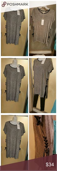 New Arrival! ??????  T-Shirt dress lace up sides New Arrival! ?????? T-Shirt dress lace up sides  Cute t-shirt Dress lace up side detail Can be worn as a Dress or a tunic with cute leggings   Sizes Available S M L  Will provide measurements upon request  I do bundle Offers are welcome (using offer button) NO Trades  NO Lowball offers Dresses