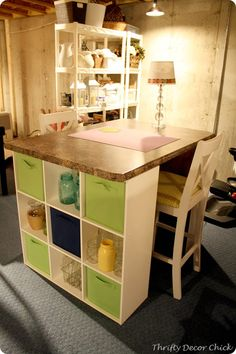 Bookshelves or storage cubes as the sides of a desk or craft table. I'm absolutely LOVING this idea.