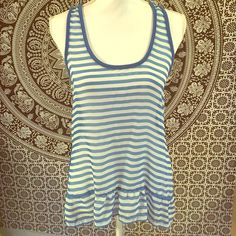 """Cute Sheer Front Tank Adorable hi-low sheer front, racerback tank top with ruffle along the bottom. The material on the front is sheer, and the back is more like t-shirt material. Great with a cute pair of shorts, or dressed up with skinny jeans and heels! Lovingly used and has slight """"pilling"""" on the solid blue back of the top, but not really noticeable and still looks great. Plenty more life to live in your closet!! (Junior size large, women's medium) Energie Tops Tank Tops"""