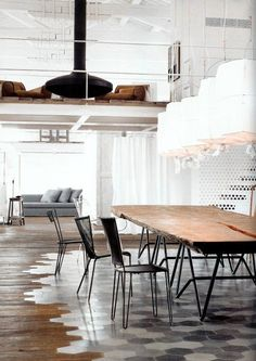 check out the floor! if you're not going to have one floor through the house, at least make it look like you did it no purpose! this is stylin'!   Vosgesparis: An industrial white home - Designed by Paola