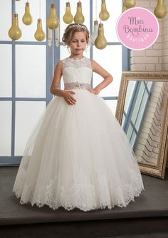 The Jackson bridesmaid dress is a sleeveless tulle dress for girls. This floor-length princess dress features a sleeveless, sheer overlay neckline and a fully gathered skirt. The dress back grabs your