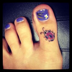My pink ladybug tattoo by Zack at InkedSanity