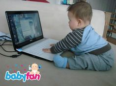 "a little baby with ""his"" laptop :)"