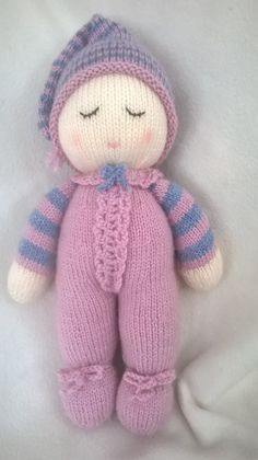 Welcome to DreamDollies.  This sleepy hand knitted Baby Dumpling Doll dreams of lots of sleepy cuddles. She is approximately 13 inches/ 33 centimetres tall and made from acrylic wool with 100% polyester toy stuffing. She is suitable for all ages as all items are sewn securely and are not removable.  Thanks for looking.