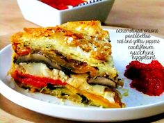 """Roasted Veggie Pie Wrapped in Phyllo -Assorted roasted vegetables of your choice  Grated parmesan or romano cheese  grated asiago, mozzarella, or fontina cheese  Phyllo sheets  Olive oil  9"""" springform pan"""