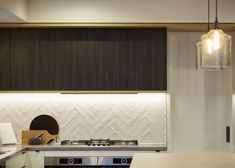 A designer kitchen and custom built cabinetry give some definite form to the space. Calley Homes Loft Spaces, Living Spaces, Exposed Rafters, Chimney Cap, Building Companies, Bedroom With Ensuite, Polished Concrete, Guest Bedrooms, Concrete Floors