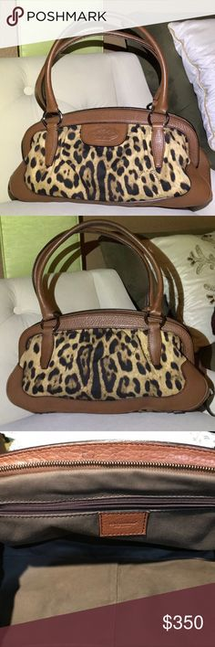 """Dolce & Gabbana Animalier Leopard print bag Authentic Dolce & Gabbana  leather and canvas Leopard print knitting bag. Dolce & Gabbana Leather logo on front sliver hardware With Dolce & Gabbana engraved on all hardware.Zipper closure. Brown interior zipper pocket. There is Two ink spots inside very small one ink spot front bottom small and small ink spot top inside. The bag is in great shape .Pre loved please see pictures 9"""" shoulder drop 16"""" wide 9""""height Dolce & Gabbana Bags Shoulder Bags"""