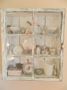 old window frame turned into a cabinet to hold special treasures!