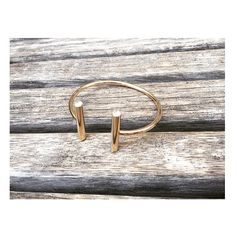 One of our favorite pieces! The Double Bar Metal Bangle Bracelet - Gold. Also available in Silver. This item is comparable to Tiffany's square bracelet, although ours is only $25.00! #helensjewels