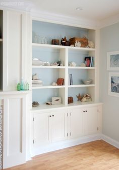 Fireplace Wall Built-ins – Courtney Reveal  ours are arched, though...so no crown on top? Wait, box the crown around the top, then paint wall white to blend...will look like an arched bookcase on top....