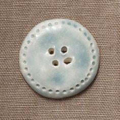 Handmade ceramic button.