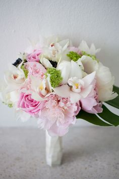 pretty bridesmaid bouquet, perhaps with more peachy/ orange instead of pink