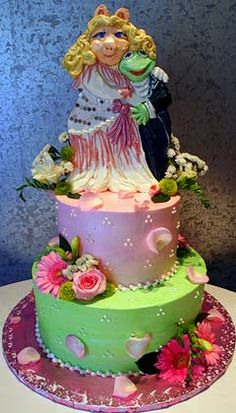 Kermit the Frog and Miss Piggy, pink and green wedding cake decorated with pink roses and pink gerbera daisies. From www.rosebudcakes.com                 ........   #wedding #cake #birthday
