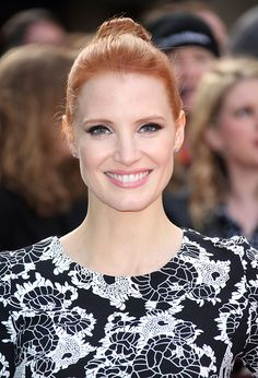 Jessica Chastain with a simple bun, flawless skin, liquid liner, shimmery eyeshadow and pink lips on March 29.