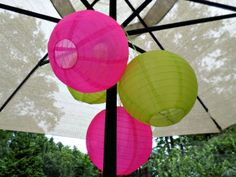 Girls Pool Party - Let's Flamingle Hot Pink and Apple Green nylon lanterns are strung on the umbrella ribs. Because they are nylon they don't fade or wilt like paper ones. Kept them up all weekend.